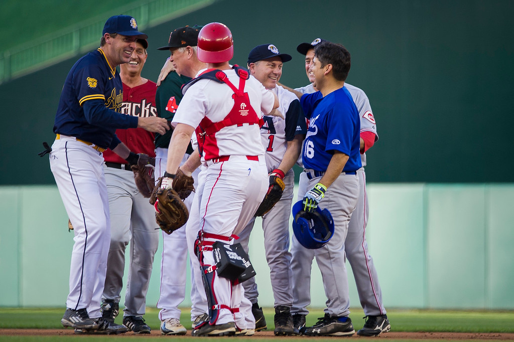. U.S. Rep. Steve Scalise, center right, is congratulated by his teammates after fielding a ground ball and making a throw to first for an out during the 57th Congressional Baseball Game at National\'s Park in Washington, Thursday, June 14, 2018. On June 14, 2017, Scalise was wounded in the leg when he and other Congressional members became victims of a shooting at the baseball field they were practicing on in Alexandria, Va. (AP Photo/Cliff Owen)