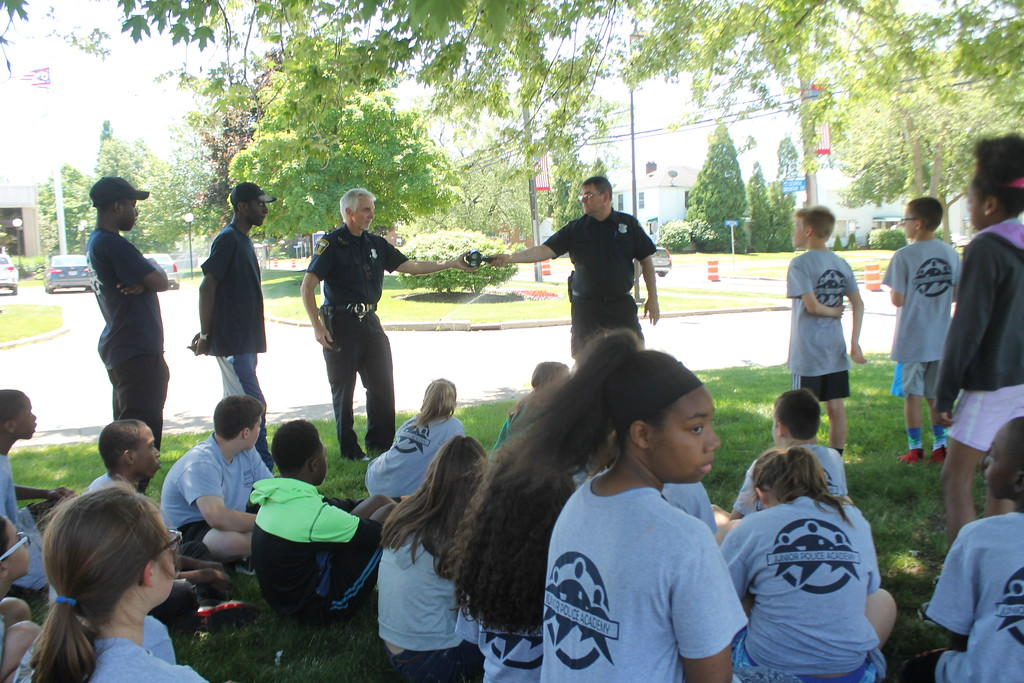 . Euclid police Officers Tony Brentar and Josh MacDonald explain to the cadets enrolled in the department\'s Jr. Police Academy about traffic stops and equipment used to tell how fast a vehicle is going. Kristi Garabrandt - The News-Herald