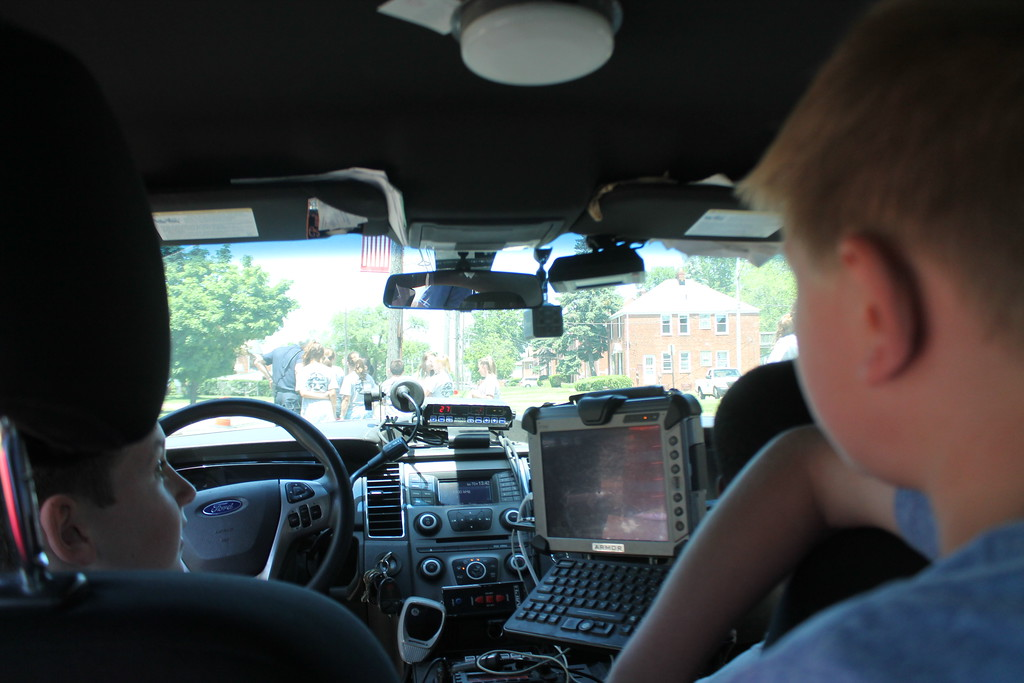 . Will Flaisman, 11,  a cadet in Euclid\'s  Police Department\'s Jr. Police Academy sits in the back seat of a squad car watching the radar to see how fast vehicles or traveling down East 222nd Street. Kristi Garabrandt - The News Herald