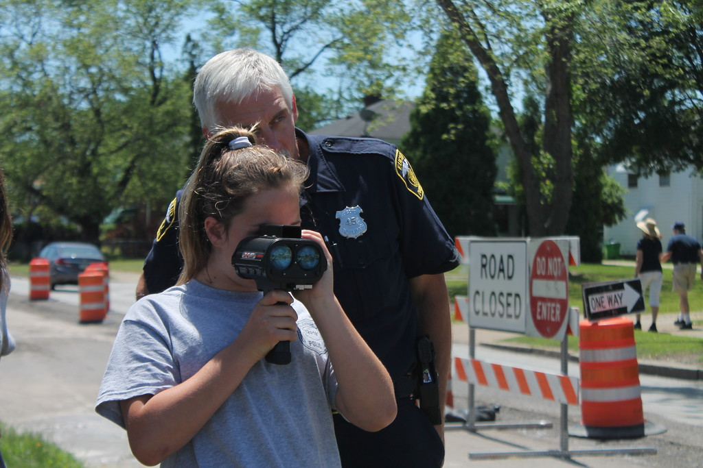 . Euclid police Officer Tony Brentar helps Marissa Ventura, 11  who is a cadet in the Euclid Police Department\'s Jr. Police Academy use radar to  tell how fast a vehicle is going. Kristi Garabrandt - The News-Herald