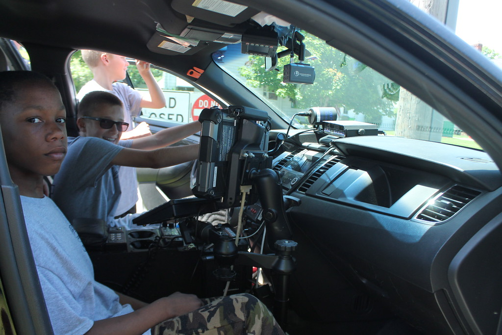 . Matthew Locsei , 11 and Robert Burford,  cadets in Euclid\'s  Police Department\'s Jr. Police Academy, sit in  a squad  car watching the radar to see how fast vehicles or traveling down East 222nd Street. Kristi Garabrandt - The News Herald