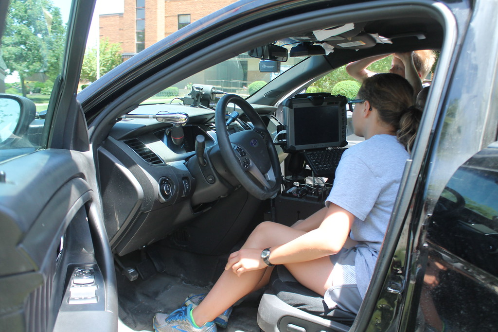 . Zoe Pesek, 12,  a cadet in Euclid\'s  Police Department\'s Jr. Police Academy sits in the front seat of a squad car watching the radar to see how fast vehicles or traveling down East 222nd Street. Kristi Garabrandt - The News Herald
