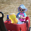 Eric Bonzar — The Morning Journal <br> One-year-old Isla Hughes hangs on to her roll of Duck Tape as she's pulled along through the festival grounds by her father Justin Hughes, of Avon, June 16, 2017. Friday kicked off the first of three days of the 14th annual Avon Heritage Duck Tape Festival.