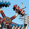 "Jonathan Tressler — The News-Herald <br> A pair of brave souls go upside-down on the ""Spin Out"" during the first few hours of the 58th Annual Kirtland Kiwanis Strawberry Festival June 15."