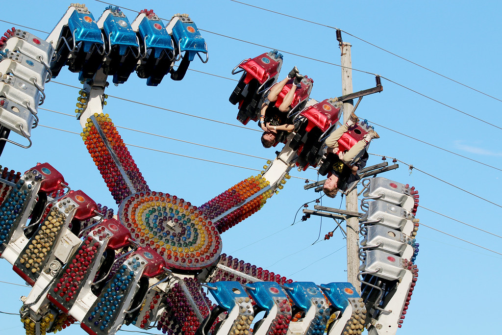 """. Jonathan Tressler � The News-Herald <br> A pair of brave souls go upside-down on the \""""Spin Out\"""" during the first few hours of the 58th Annual Kirtland Kiwanis Strawberry Festival June 15."""