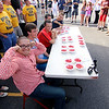 "Jonathan Tressler — The News-Herald <br> New strawberry shortcake-eating champ Ivan ""The Avocado"" Mendoza flexes his guns before becoming the new champ at the 58th Annual Kirtland Kiwanis Strawberry Festival June 15."