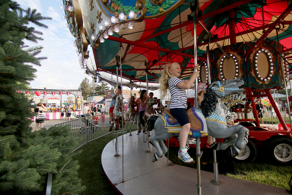 . Jonathan Tressler � The News-Herald <br> Some young equestrians of the plastic-horse kind ride with glee during opening day of the 58th Annual Kirtland Kiwanis Strawberry Festival June 15.