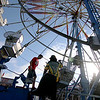 Jonathan Tressler — The News-Herald <br> Soon-to-be-riders board their carriages on the Ferris wheel June 15 during opening day of the 58th Annual Kirtland Kiwanis Strawberry Festival.