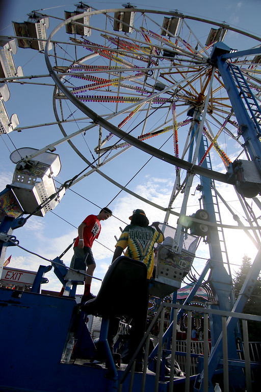. Jonathan Tressler � The News-Herald <br> Soon-to-be-riders board their carriages on the Ferris wheel June 15 during opening day of the 58th Annual Kirtland Kiwanis Strawberry Festival.