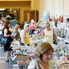 Jonathan Tressler — The News-Herald <br> Shoppers browse the flea market offerings inside the Kirtland Schools' buildings June 15 during opening day of the 58th Annual Kirtland Kiwanis Strawberry Festival