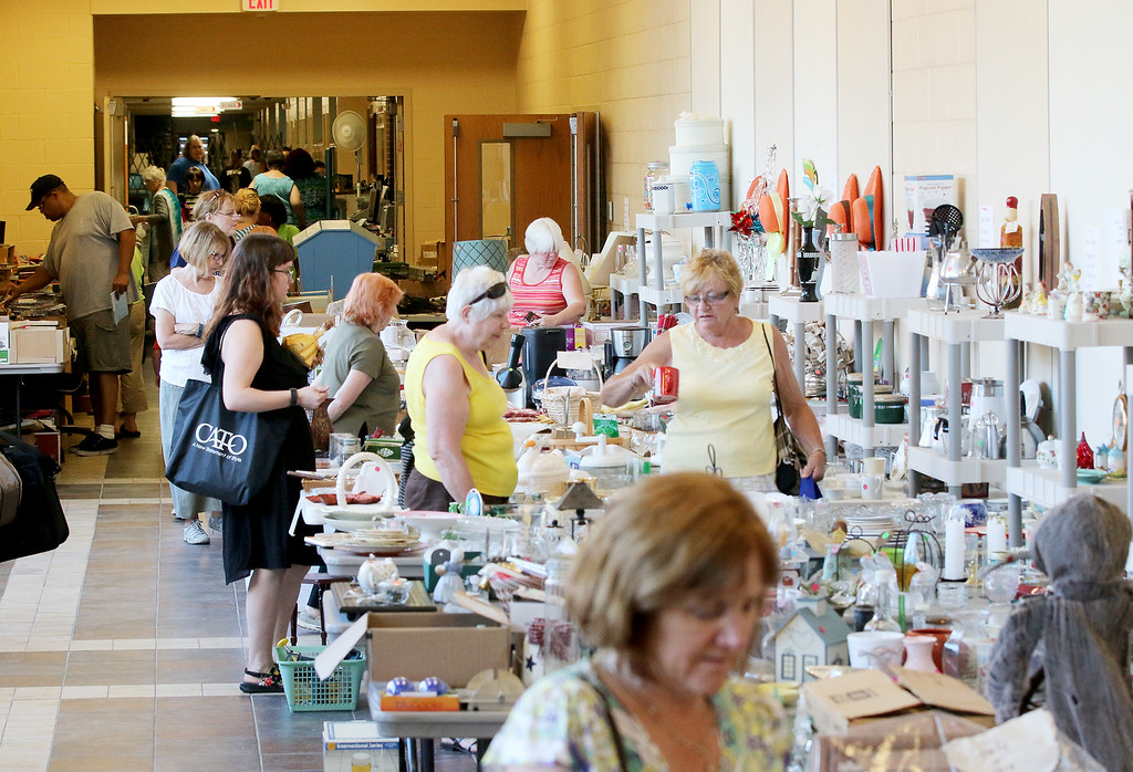 . Jonathan Tressler � The News-Herald <br> Shoppers browse the flea market offerings inside the Kirtland Schools\' buildings June 15 during opening day of the 58th Annual Kirtland Kiwanis Strawberry Festival