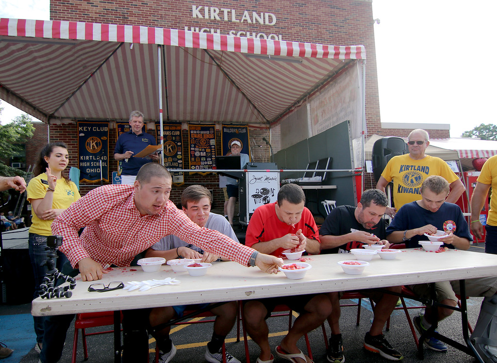 """. Jonathan Tressler � The News-Herald <br> The new Kirtland Kiwanis Strawberry Festival shortcake-eating contest champ Ivan \""""The Avocado\"""" Mendoza, who hails from Sheffield, reaches for his sixth and final shortcake during the contest on festival\'s opening day June 15, 2017."""