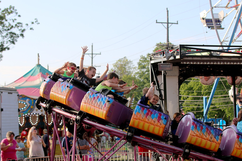 . Jonathan Tressler � The News-Herald <br> The dragon-coaster delivers some thrills to the younger crowd at the 58th Annual Kirtland Kiwanis Strawberry Festival during its opening day June 15.