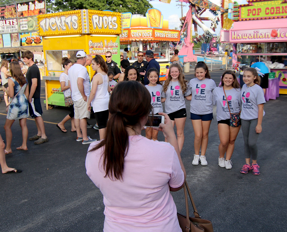 . Jonathan Tressler � The News-Herald <br> A smart-phone photo of some of the cheer-leading talent gets snapped during the opening day of the 58th Annual Kirtland Kiwanis Strawberry Festival during its opening day June 15.