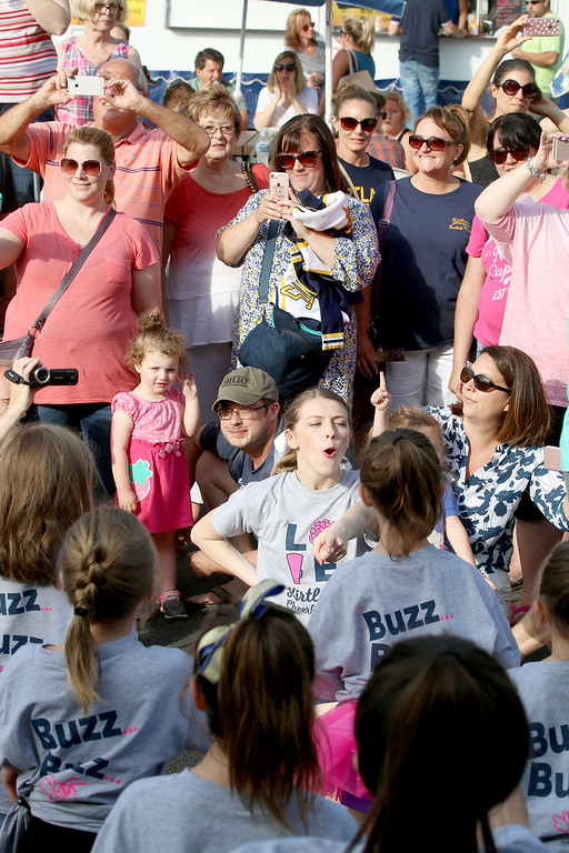 . Jonathan Tressler � The News-Herald <br> Proud parents snap, shoot and smile as Kirtland\'s junior cheerleaders do their thing for the crowd June 15 during opening day of the 58th Annual Kirtland Kiwanis Strawberry Festival.