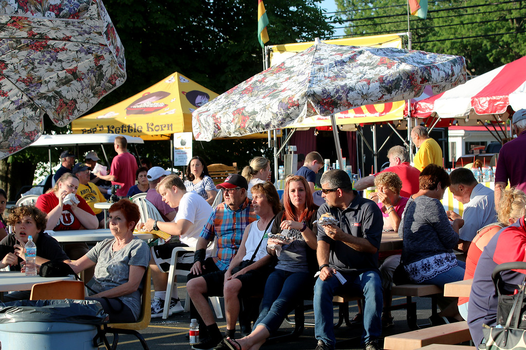 . Jonathan Tressler � The News-Herald <br> Visitors to the 58th Annual Kirtland Kiwanis Strawberry Festival enjoy the various versions of festival food during the fest\'s opening day June 15, 2017.
