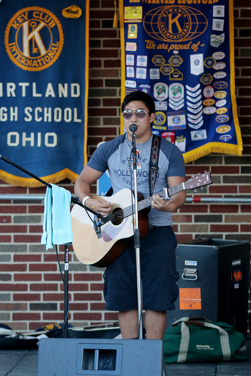 . Jonathan Tressler � The News-Herald <br> Kirtland High School soon-to-be-senior Chaz McPeak plays a number for the crowd during his performance on opening day of the 58th Annual Kirtland Kiwanis Strawberry Festival June 15.