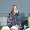Kaylee Remington - The Morning Journal<br /> Emily Keener, of Wakeman, sang the National Anthem before the Kalahari Resorts Duck Tape Fashion Show on June 18. The 13th Annual Avon Heritage Duck Tape Festival was held June 17 to June 19. About 60,000 were expected to attend the popular event