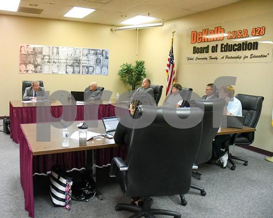 DeKalb Superintendent of schools Mr. Jamie Craven listens to Mr. Tim Vincennt as he speaks on the 2018-2019 Parent/Student Handbook Revisions.
