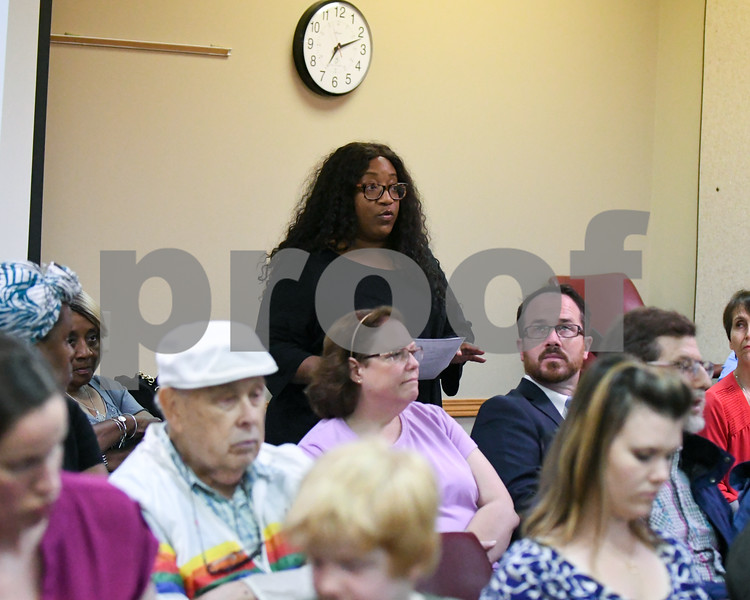 Kandace Stovall talks at the DeKalb school board meeting with questions about the on going investigation of residency on June 19.