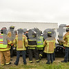 Keith Fritz Lutendnt for 19 years of DeKalb fire department ( In black) talks to the students of Kishwaukee Education Consortium program  June 19th as they learn how to extract people from vehicles.
