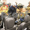 Rochelle senior Clarissa Dodillet uses the Jaws of Life to remove the door from the hinges on a demo car on June 19 during the Kishwaukee Education Consortium program to help students become trained to be firefighters.