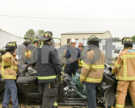 Josh Lewis of Rochelle fire department talks to the students of Kishwaukee Education Consortium program June 19th as they learn how to extract people from vehicles.