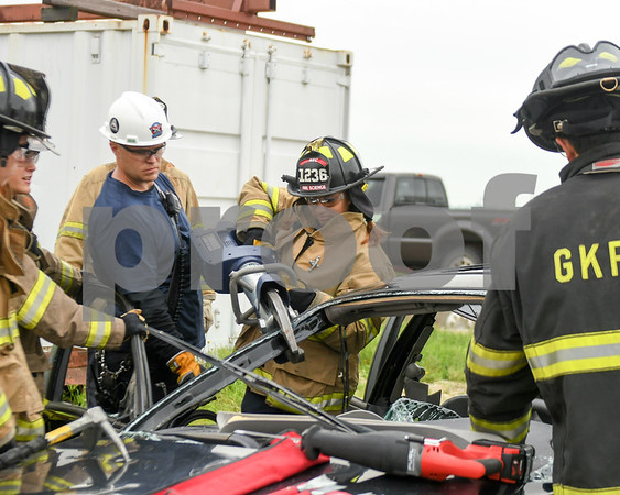 kylie Nunez a Senior at DeKalb high school uses the Jaws Of Life on a demo car during the June 19th extraction portion of Kishwaukee Education Consortium program.
