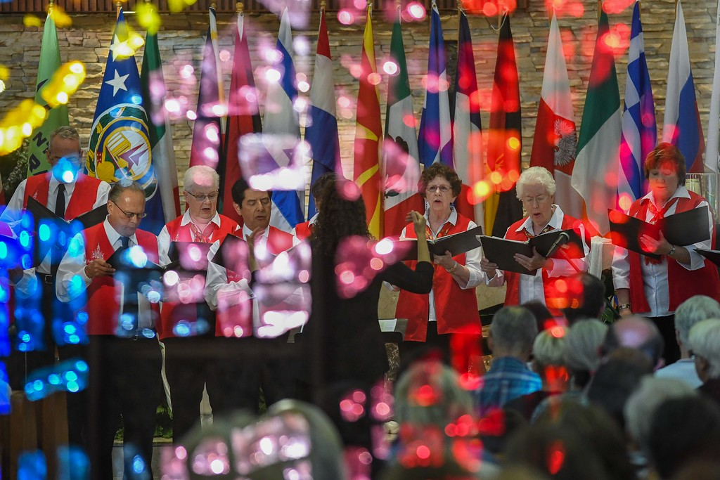 . Eric Bonzar � The Morning Journal <br> Members of the Nativity of the Blessed Virgin Mary choir are seen performing, through the reflection of stained glass, during the 41st annual Heritage of Sacred Music Concert, June 20, 2017. The concert, held at St. Peter Parish, 3655 Oberlin Ave, Lorain, was presented by the Lorain International Association.