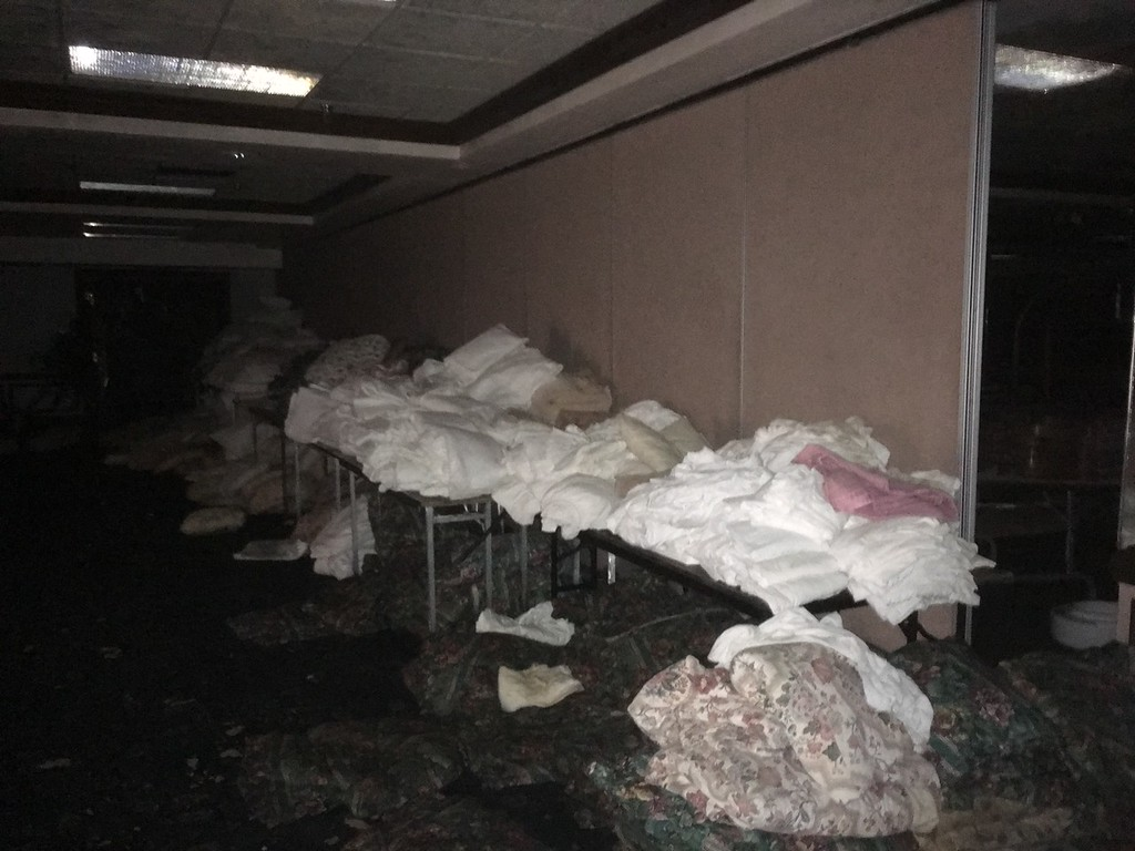 . Zachary Srnis - The Morning Journal <br> Former dining hall in hotel\'s basement. It currently serves as storage of old sheets, pillows and mattresses.