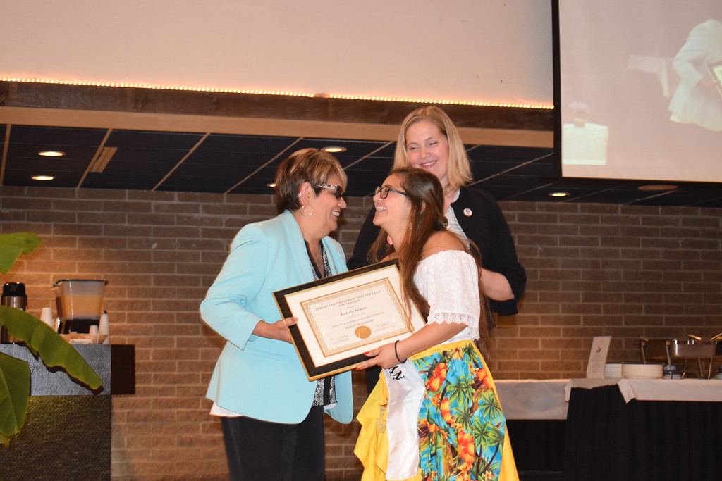 . Briana Contreras - The Morning Journal <br> From left, Margarita Quinones of the LCCC Board of Trustees and Lisa Brown, executive director of the LCCC Foundation congratulate International Puerto Rican Princess Ivelysse Gracia as the Heritage Winner of the LCCC International Festival Scholarship during the Annual International Festival Breakfast on June 20.