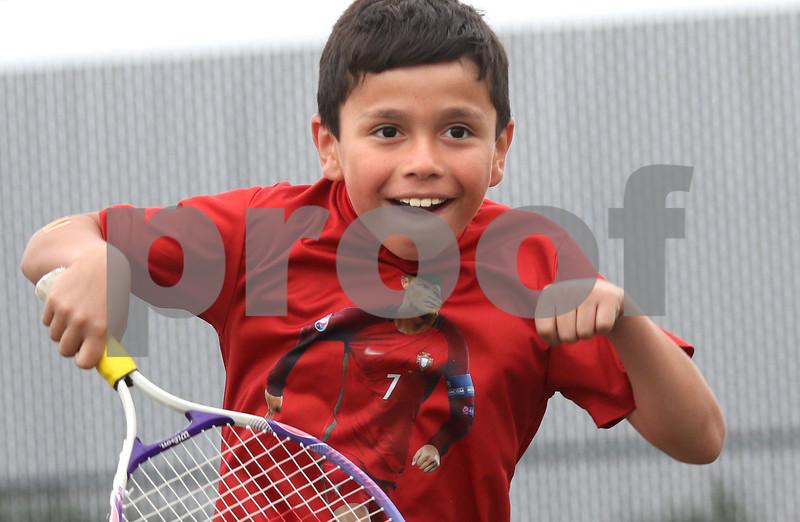 dc.sports.0622 dek tennis05