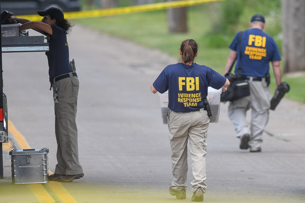 . Eric Bonzar � The Morning Journal <br> FBI agents, Middleburg Heights police, and Elyria police search a wooded area near Mussey Avenue in Elyria, in connection with the March 2015 disappearance of Middleburg Heights resident Tierra Bryant, who was 19 years old at the time she went missing.