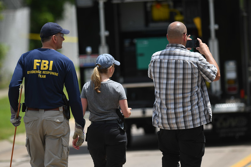 Eric Bonzar — The Morning Journal <br> FBI agents, Middleburg Heights police, and Elyria police search a wooded area near Mussey Avenue in Elyria, in connection with the March 2015 disappearance of Middleburg Heights resident Tierra Bryant, who was 19 years old at the time she went missing.