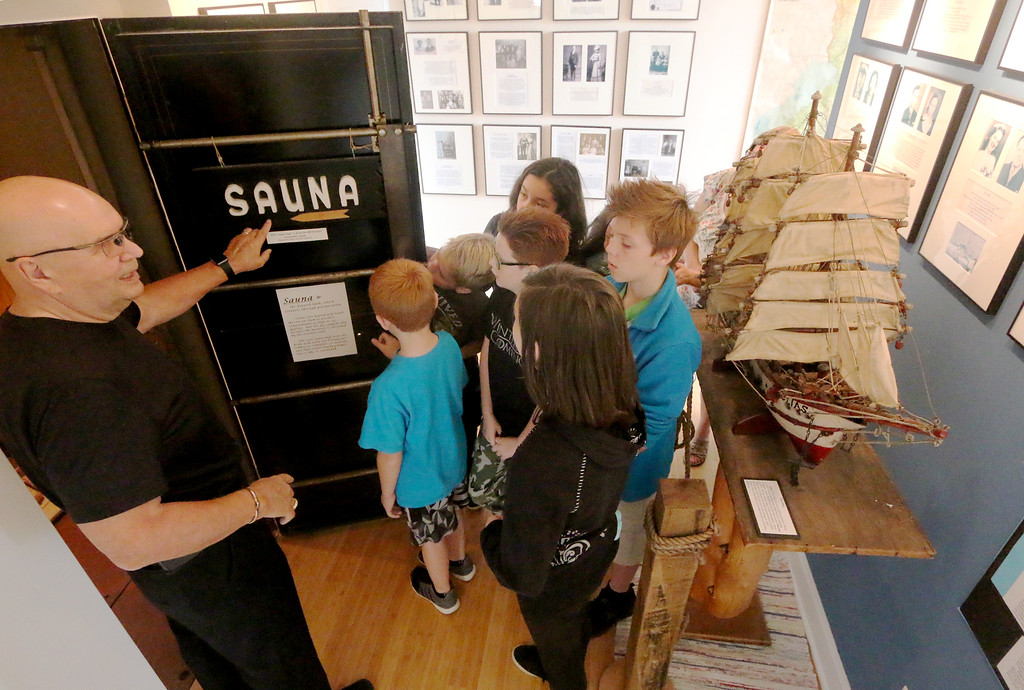 . Jonathan Tressler � The News-Herald <br> Finnish Heritage Museum President Lasse Hiltunen shows the museum\'s sauna replica to a group of fifth graders from McKinley Elementary School in this Oct. 19 photo.