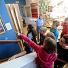 "Jonathan Tressler — The News-Herald <br> Finnish Heritage Museum curator Suzanna Jokela shows a group of McKinley Elementary School fifth graders Edvard Isto's patriotic, anti-Russian protest painting ""The Attack"" during the students' visit to the museum Oct. 19."