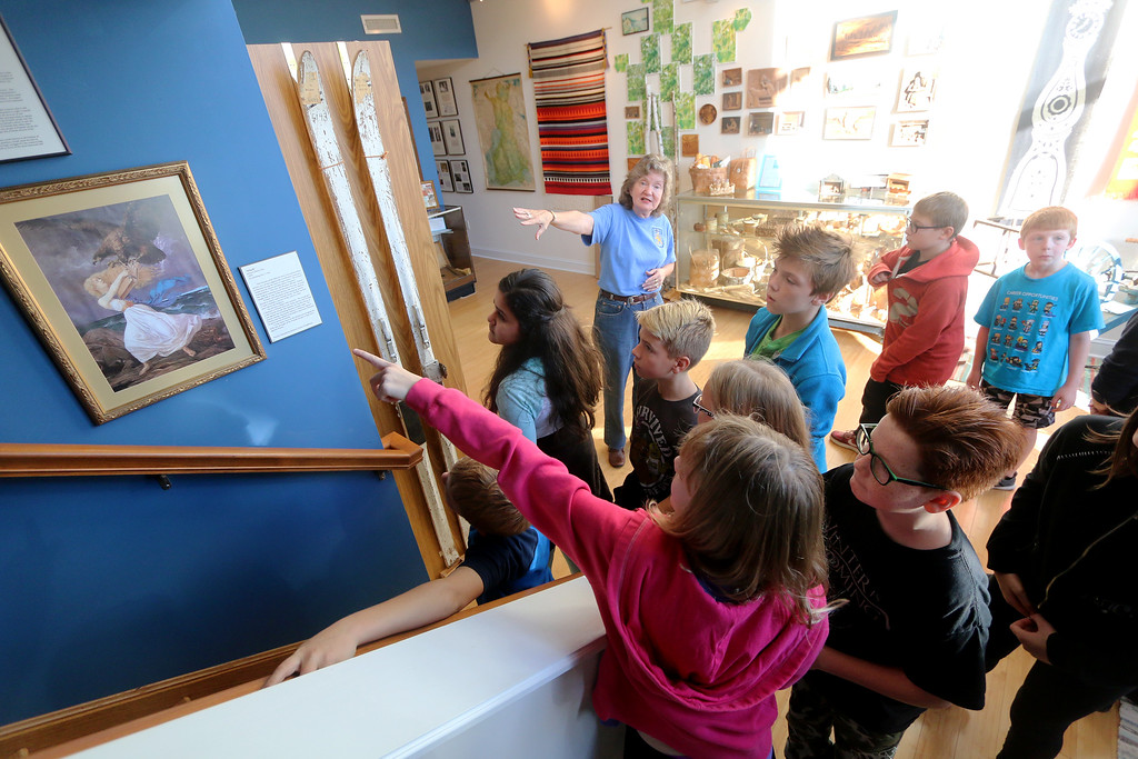 . Jonathan Tressler � The News-Herald <br> Finnish Heritage Museum curator Suzanna Jokela shows a group of McKinley Elementary School fifth graders Edvard Isto�s patriotic, anti-Russian protest painting �The Attack� during the students� visit to the museum Oct. 19.