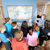 Jonathan Tressler — The News-Herald <br> Finnish Heritage Museum curator Suzanna Jokela shows a group of McKinley Elementary School fifth graders a Finnish-made knife inside the museum in this Oct. 19 photo.