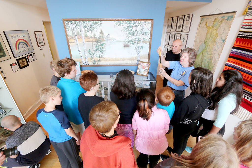 . Jonathan Tressler � The News-Herald <br> Finnish Heritage Museum curator Suzanna Jokela shows a group of McKinley Elementary School fifth graders a Finnish-made knife inside the museum in this Oct. 19 photo.