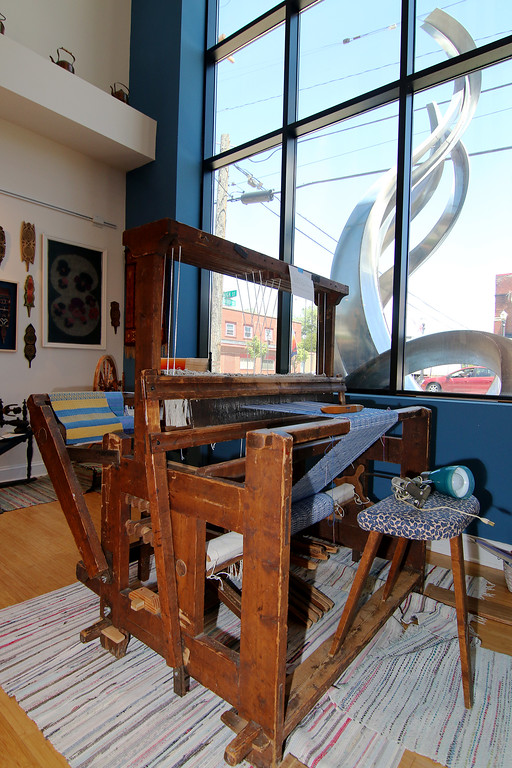 . Jonathan Tressler � The News-Herald <br> A view of the loom, and the sculpture out front, from inside the Finnish Heritage Museum in Fairport Harbor.