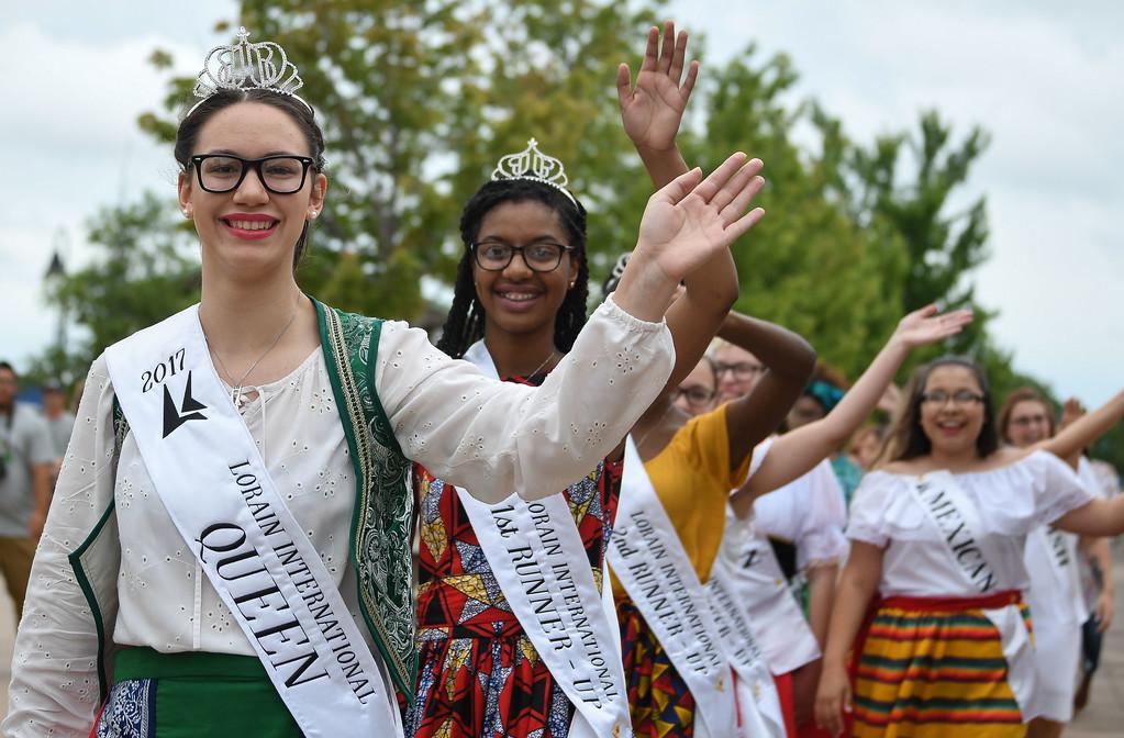 . Eric Bonzar � The Morning Journal <br> Lorain International Queen Madison Maniaci leads the parade of princesses through Black River Landing, signifying the start of the 51st annual Lorain International Festival, June 23, 2017.