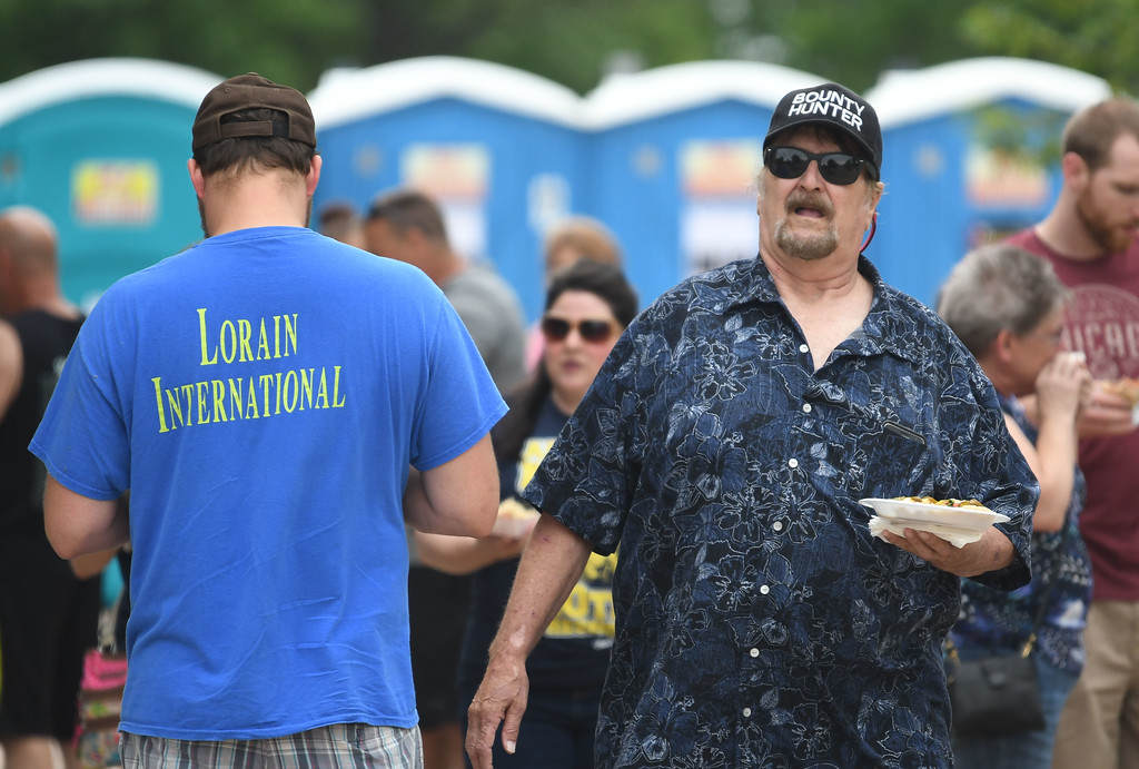 . Eric Bonzar � The Morning Journal <br> Festival-goers converged on Black River Landing to celebrate the city\'s diverse culture, with music, dance and food during the 51st annual Lorain International Festival, June 23, 2017.