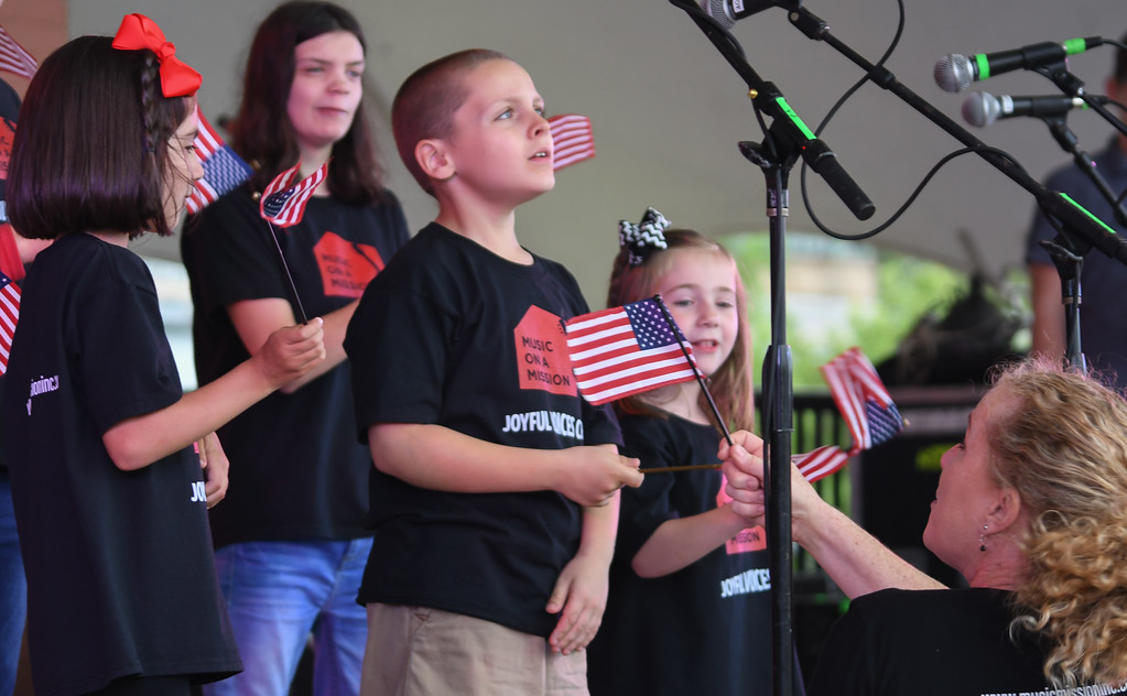 . Eric Bonzar � The Morning Journal <br> The Joyful Voices Choir perform the National Anthem to kick off the 51st annual Lorain International Festival, June 23, 2017.