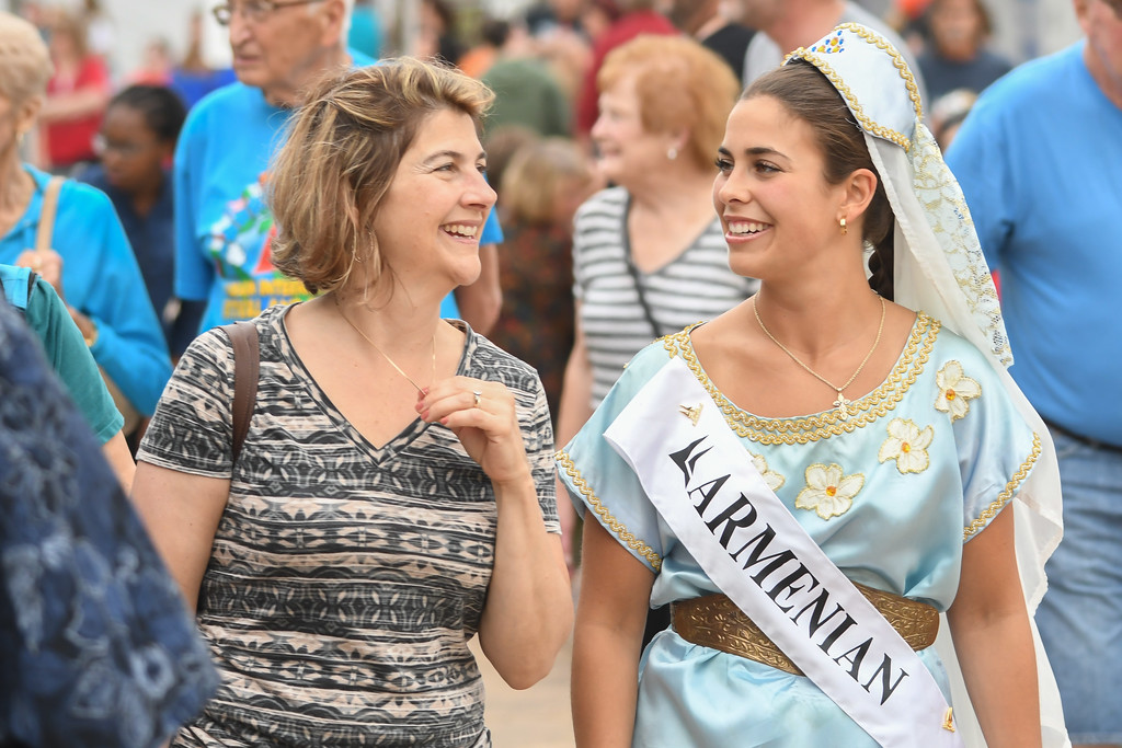 . Eric Bonzar � The Morning Journal <br> Armenian Princess Natalie Butchko strolls the grounds of the 51st annual Lorain International Festival, with her mother Tracy Butchko, June 23, 2017. Natalie is pictured in the dress her mother wore when she served as the 1987 Lorain International Queen, the Butchko\'s said.