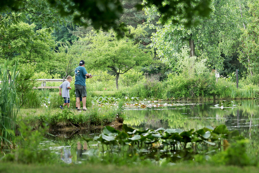 . Jonathan Tressler � The News-Herald <br> The pond behind the nature center at Lake Metroparks� Penitentiary Glen sees some action from some casual anglers between rain showers June 23 during the park system\'s Great American Backyard Campout.