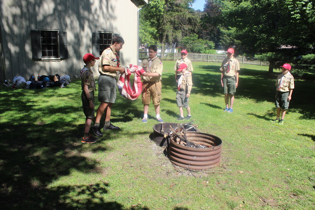 . Boy Scout Troop 383 holds flag retirement ceremony at the James A. Garfield National Historic Site on June 24. (Tawana Roberts/The News-Herald)