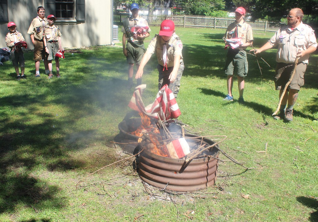 . Boy Scout Troop 383 properly and respectfully retires flags on June 24 at the James A. Garfield National Historic Site. (Tawana Roberts/The News-Herald)