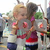 """Aimee Barrows – for Shaw Media<br /> Eleanor Hooper, 7, of Sycamore holds a snake during the annual """"Rockin' for the Reptiles"""" fundraiser for the Midwest Museum of Natural History on a sunny Saturday afternoon in downtown Sycamore."""