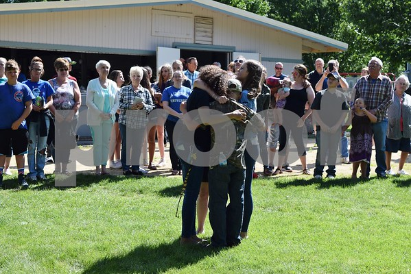 Les Bellah's grandchildren hold each other and cry during his celebration of life gathering Saturday at Franklin Township Park in Kirkland. Bellah, who served as the Kirkland Village President from 1997-2005 and from 2008-2017, died June 4.
