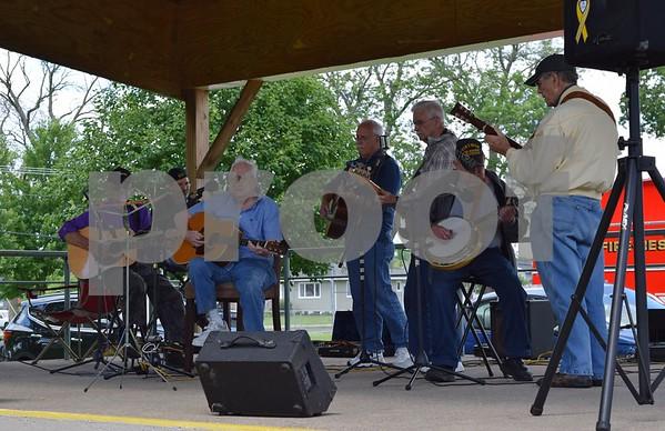 Katrina J.E. Milton - kmilton@shawmedia.com<br /> Bluegrass band Kilbuck performs at longtime Kirkland Village President Les Bellah's celebration of life held Saturday at Franklin Township Park. Bellah performed with the band as a guitarist.